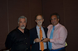 Steve Ivy (center) is inducted into the PCGS CoinFacts Coin Dealer Hall of Fame by David Hall (left), Co-Founder of PCGS, and Kevin Lipton (right) on August 8, 2014 at the **ANA** World's Fair of Money.